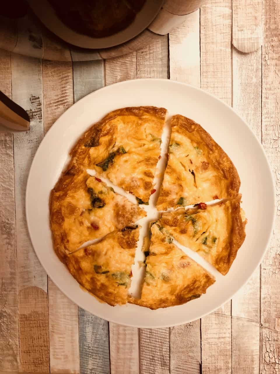 frittata on a plate by an air fryer