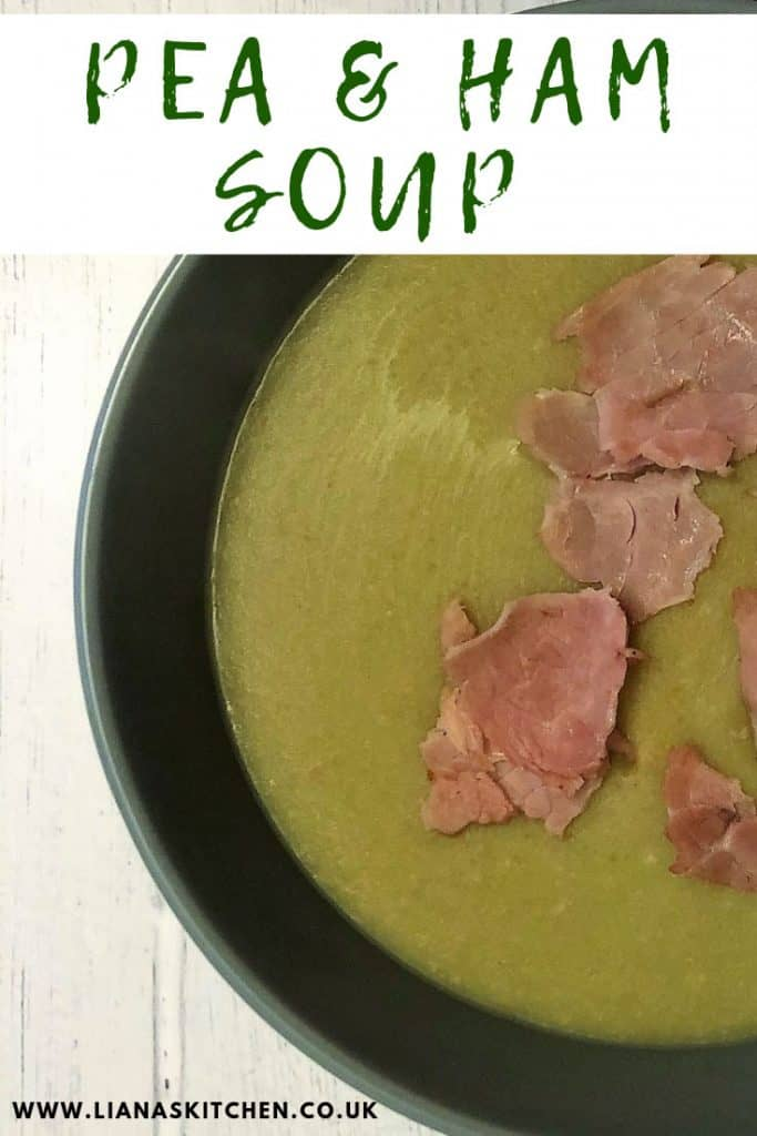 Pea and ham soup in a bowl with shredded ham on top