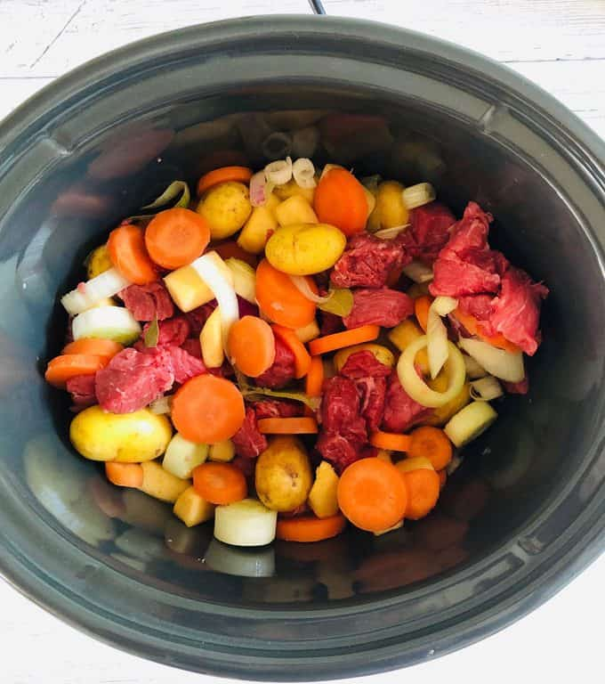 beef stew ingredients in slow cooker pot
