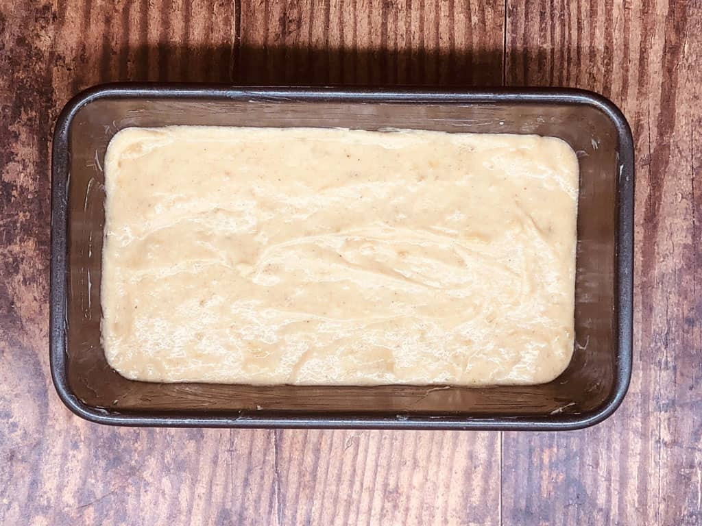 banana bread mixture in loaf tin ready to bake in the oven