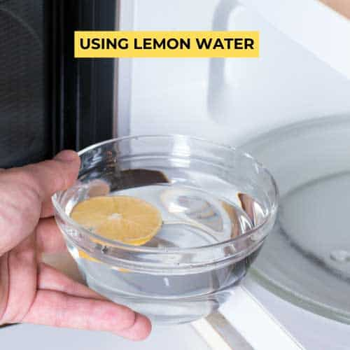 putting bowl of lemon water in the microwave