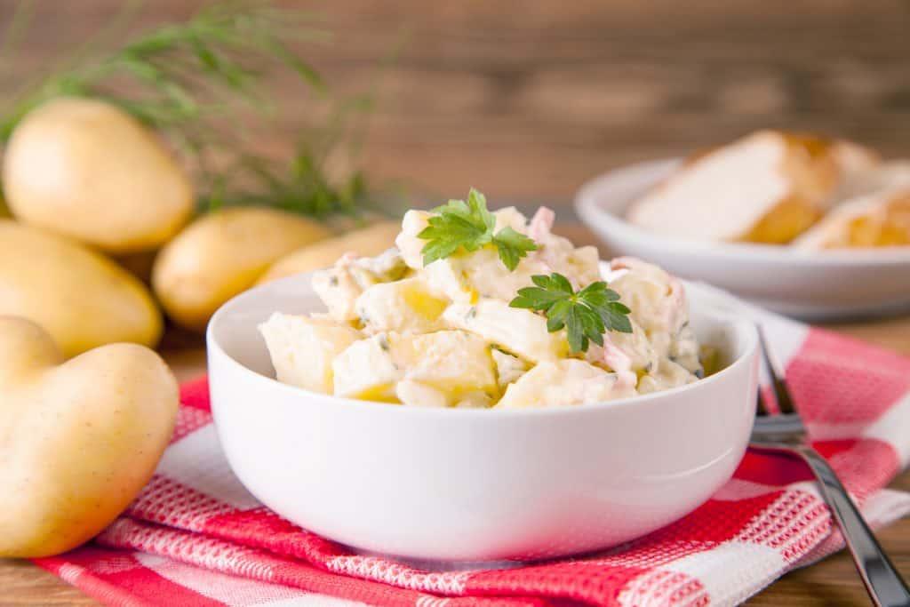 charlotte potatoes next to a prepared potato salad recipe