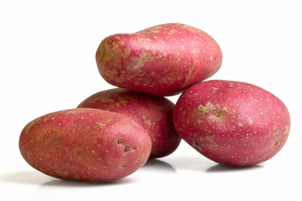 4 Desiree potatoes balanced on top of each other