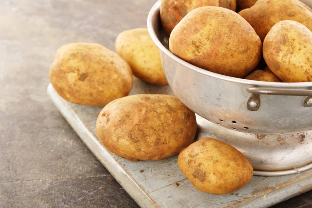preparing King Edward potatoes in colander