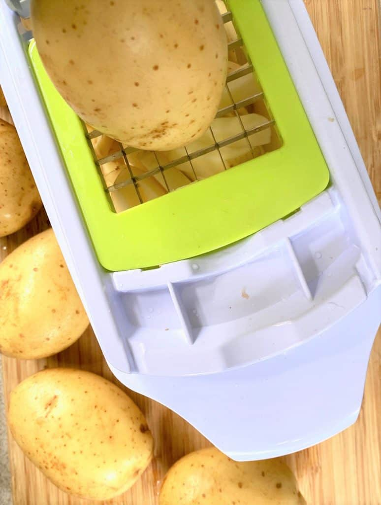 potato on chipper ready to be turned into chips