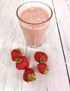 strawberry and banana smoothie with fresh strawberries