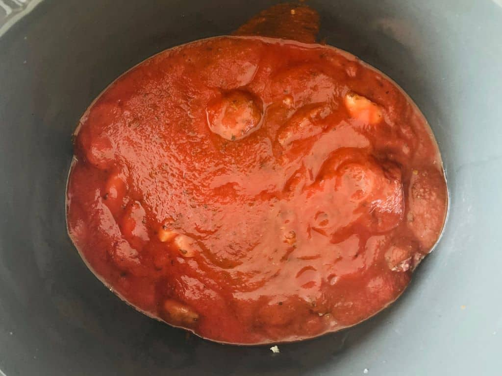 tomato sauce over meatballs in slow cooker